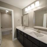 Custom upstairs bathroom of the Triple Crown by Design Homes.