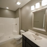 Custom downstairs bathroom of the Triple Crown, by Design Homes.