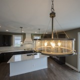 Custom lighting in the breakfast room, of the Triple Crown by Design Homes.