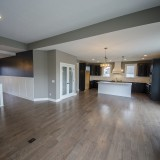 Custom great room opening up to kitchen of the Triple Crown by Design Homes.
