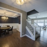 Custom entry and stairwell by Design Homes, custom home builder.