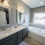Custom master bath by Design Homes, custom home builder.