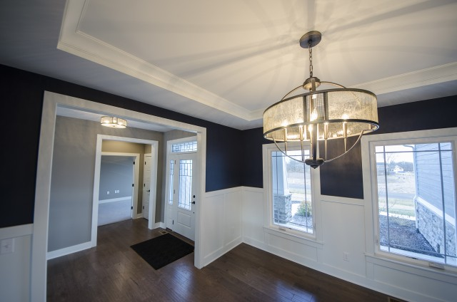 Custom lighting in the dining room of the Triple Crown by Design Homes.