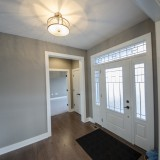 Custom foyer of the Triple Crown by Design Homes.