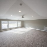 Custom upstairs game room of the Triple Crown by Design Homes.