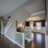 Customs stairwell in the Triple Crown by Design Homes.