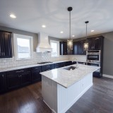 Custom kitchen in the Triple Crown by Design Homes.