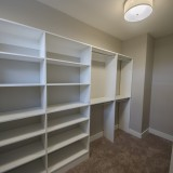 Custom walk-in closet in the Triple Crown by Design Homes.