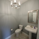 Custom powder room in the Triple Crown by Design Homes.