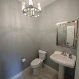 Custom powder room in the Triple Crown by Design Homes.