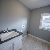 Custom laundry room in the Triple Crown by Design Homes.