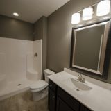 Custom bathroom of The Triple Crown (Lot 163) in Cypress Ridge. A move-in ready home by Design Homes and Development.