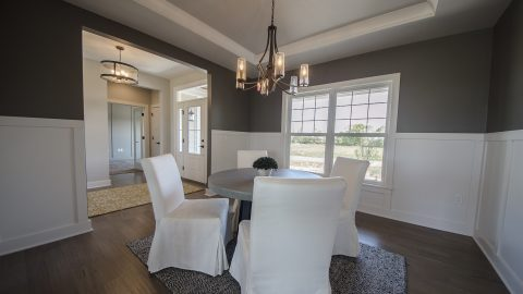 Custom dining room in The Triple Crown. Built by Design Homes & Development.