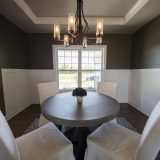 Custom dining room of The Triple Crown (Lot 163) in Cypress Ridge. A move-in ready home by Design Homes and Development.