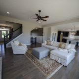 Custom great room of The Triple Crown (Lot 163) in Cypress Ridge. A move-in ready home by Design Homes and Development.