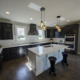 Custom kitchen of The Triple Crown (Lot 163) in Cypress Ridge. A move-in ready home by Design Homes and Development.