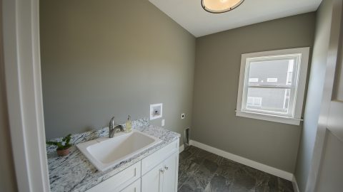 Custom Laundry Room in the Triple Crown plan by Design Homes